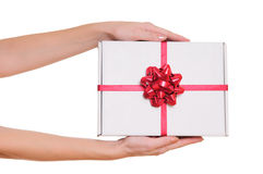 Hands holding gift box Stock Images