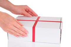 Hands holding gift box Royalty Free Stock Image
