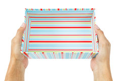Hands holding gift box Stock Photography