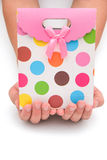 Hands holding a gift box Royalty Free Stock Images