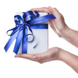 Hands Holding Gift In Package With Blue Ribbon Royalty Free Stock Photo