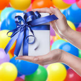 Hands holding gift in package Stock Image