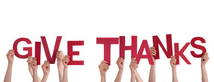 Hands Holding Give Thanks. Many Hands Holding the Red Words Give Thanks, Isolated stock image