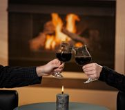 Hands holding glas of wine Stock Images