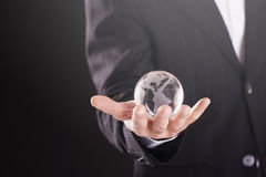 Hands holding a glass globe.  Stock Photos