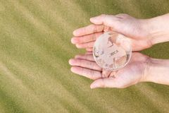 Hands Holding Glass Globe stock photos