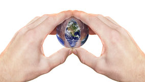 Hands holding glass globe Royalty Free Stock Photos