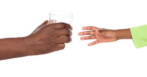 Hands holding glass Royalty Free Stock Images