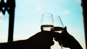 Glasses with champagne against the sky. stock footage