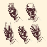 Hands holding glasses with drinks beer, tequila, vodka, rum, whiskey, wine. vector engraved illustration Stock Photography