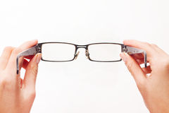 Hands Holding Glasses. Eyeglasses. Stock Images