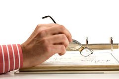 Hands holding glasses and a folder with documents Royalty Free Stock Image