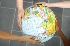 Hands holding a globe Stock Images