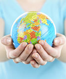 Hands holding globe royalty free stock image