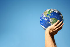 Hands holding globe Royalty Free Stock Photography