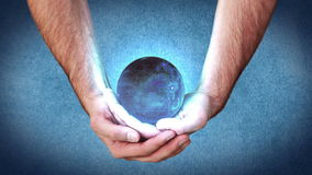 Hands holding a globe activating videos Stock Images