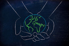 Hands holding globe, concept of green economy Stock Photography