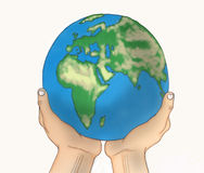 Hands holding a globe over white Stock Photography