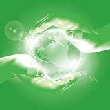 Hands holding globe. Symbol of environmental prote Royalty Free Stock Image