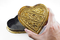 Hands holding golden heart Stock Photography