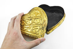 Hands holding golden heart Royalty Free Stock Images