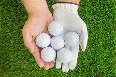 Hands holding 6 golf balls royalty free stock photos
