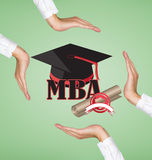Hands holding graduation cap Royalty Free Stock Images