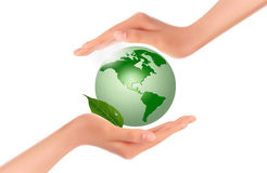 Hands holding a green earth Stock Photos