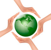 Hands holding a green earth. Royalty Free Stock Photos