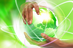 Hands holding green earth Stock Photography