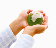 Hands holding a green earth, isolated on white Stock Photo