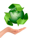 Hands holding a green earth.  Vector Stock Photo