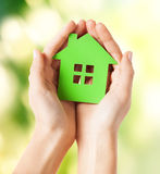 Hands holding green house Stock Images