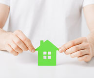 Hands holding green house Stock Photos