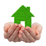 Hands holding green house symbol Royalty Free Stock Photos