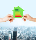 Hands holding green paper house Royalty Free Stock Image