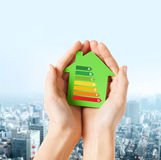 Hands holding green paper house Royalty Free Stock Photos