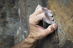 Hands holding grip. Hands of a man climbing on granite Royalty Free Stock Photos
