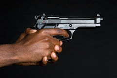 Hands Holding Gun Stock Photos