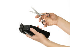 Hands holding hair clipper and scissor, isolated on white Stock Images