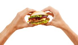 Hands holding a hamburger Royalty Free Stock Photo