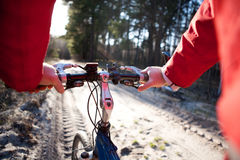 Hands holding handlebar of a bicycle Royalty Free Stock Image