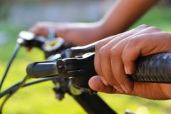 Hands holding the handlebars on the bike Stock Photography