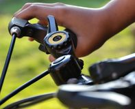 Hands holding the handlebars on the bike Royalty Free Stock Image