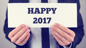 Hands holding Happy 2017 placard Stock Photo