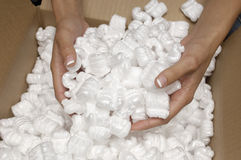 Hands Holding Heap Of Packing Peanuts Stock Images