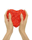 Hands holding heart. Female hands holding a big red heart, isolated on white background Royalty Free Stock Photography