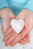 Hands holding heart. Womans hands holding a heart in her hands royalty free stock image