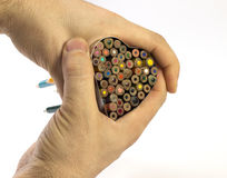 Hands holding heart - love. Love concept: hands holding heart made of colored crayons Stock Photos