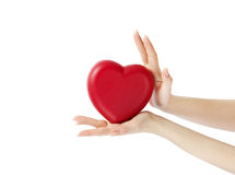 HANDS HOLDING A HEART stock images